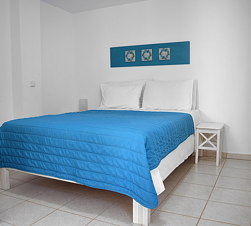 Seperate bedroom with double in holiday one bedroom apartments